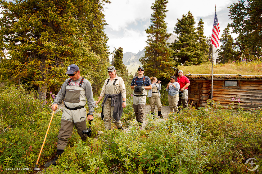 """Stu and Linda Kuehl, Mitchell and Amanda Seekman, and Nadia and Daniel """"Scooter"""" Gatsch visit Dick Proenneke's historic cabin site. Proenneke was an Alaskan mountain man who hand-built the cabin in the 1960s."""