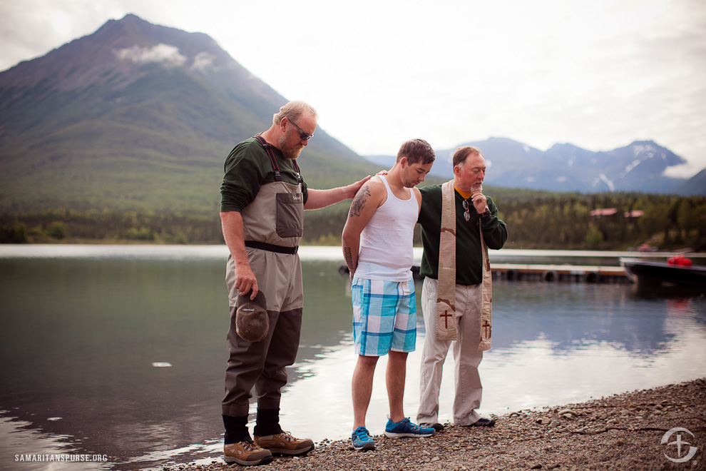 """At the end of the week, Shawn told Chaplain Fisher that he had come to faith in Jesus a few weeks earlier. On the final day at Samaritan Lodge Alaska, he was baptized in the waters of Lake Clark. """"This is a guy who has gone through it all, and he realizes that Christ is the healer, the only one who can touch his body and his soul,"""" Fisher said."""