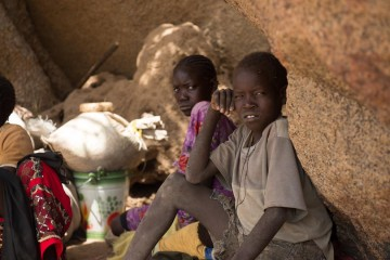 Sudanese people are forced to flee their homes and live in caves due to attacks by the government.