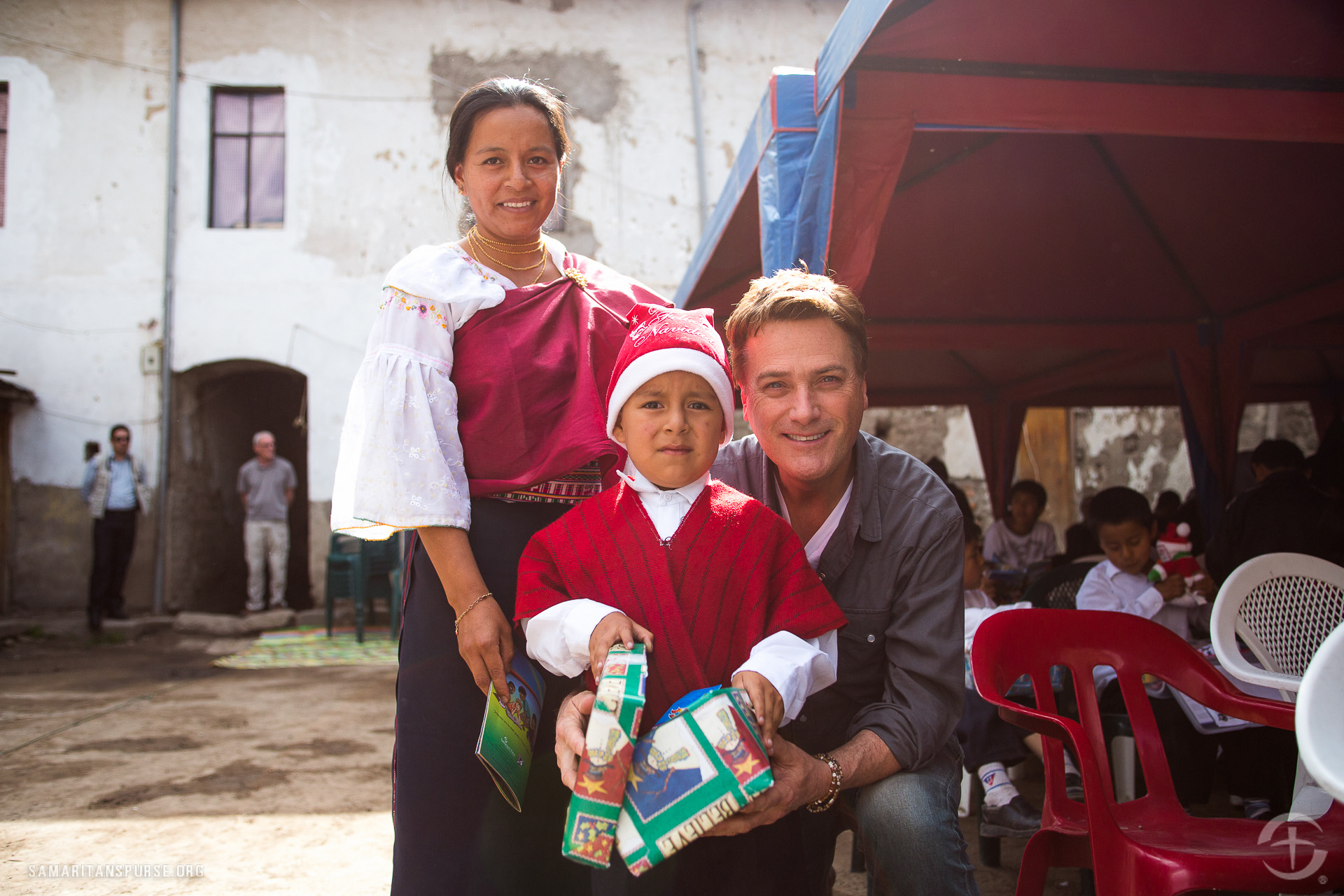 Michael W. Smith, one of the most popular singers in contemporary Christian music, has made several trips with Samaritan's Purse to deliver shoe box gifts.