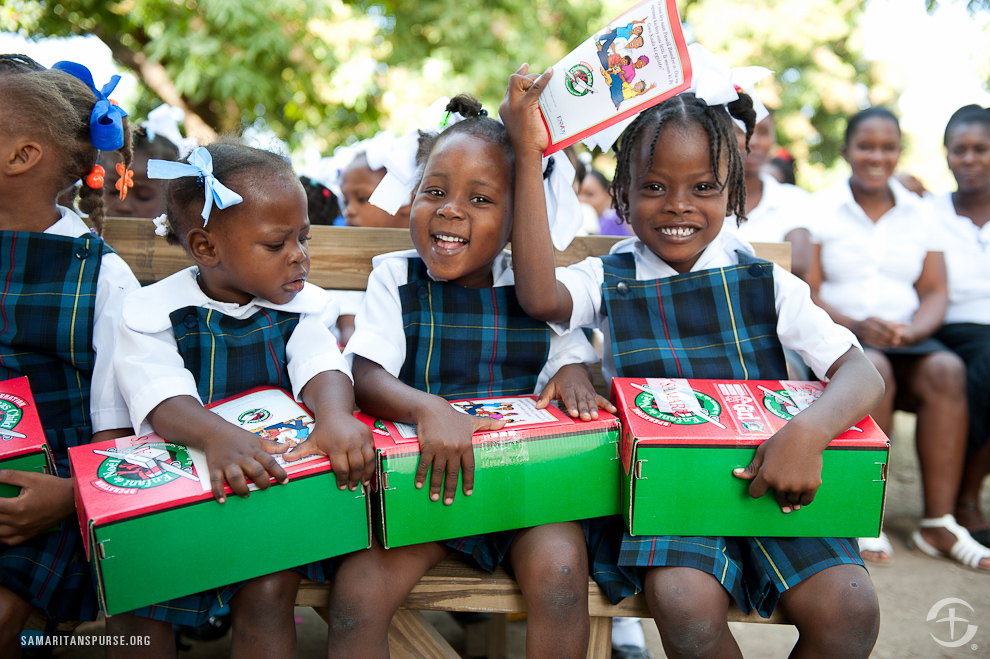 Jill hannity gives a shoe box gift to a girl in the dominican republic