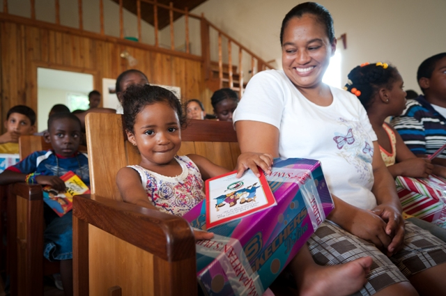 A child in Belize receives their shoebox gift