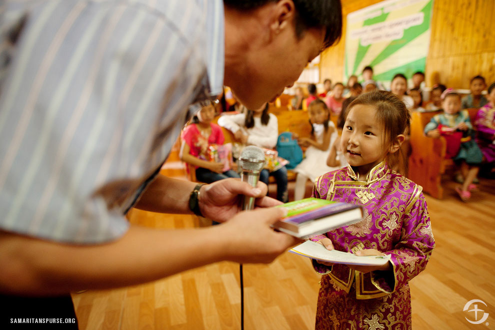 In many countries around the world, Bibles are rare and they become instant treasures, not only to the children receiving them, but to their families and friends as well.