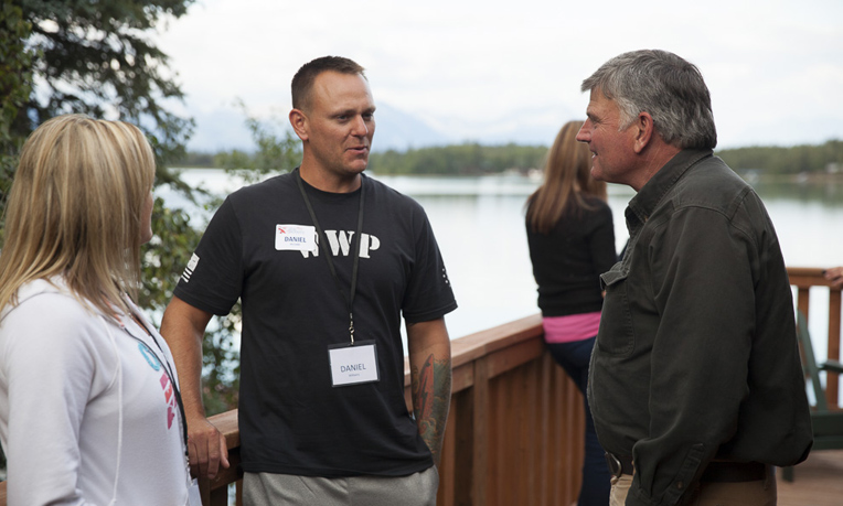 Franklin Graham talks with Army Staff Sergeant Daniel Williams and his wife, Andrea.