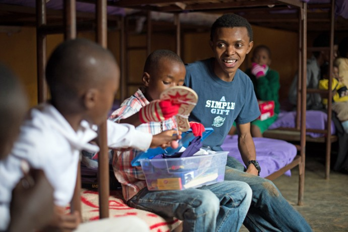 In one of his old bedrooms at Gisimba Memorial Center, Alex visits with boys who currently live at the orphanage as they explore the treasures in their shoebox gifts.