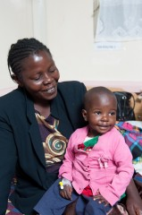 18-month-old Faith is all smiles with her mother Grace. She was the first in line for life-saving heart surgery in Kenya.