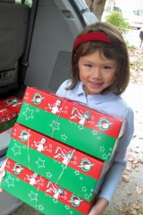 Kate helps take the shoebox gifts on the next step of their journey. They will go from Karen's house to a collection site, to a Processing Center, and then into the waiting arms of children.