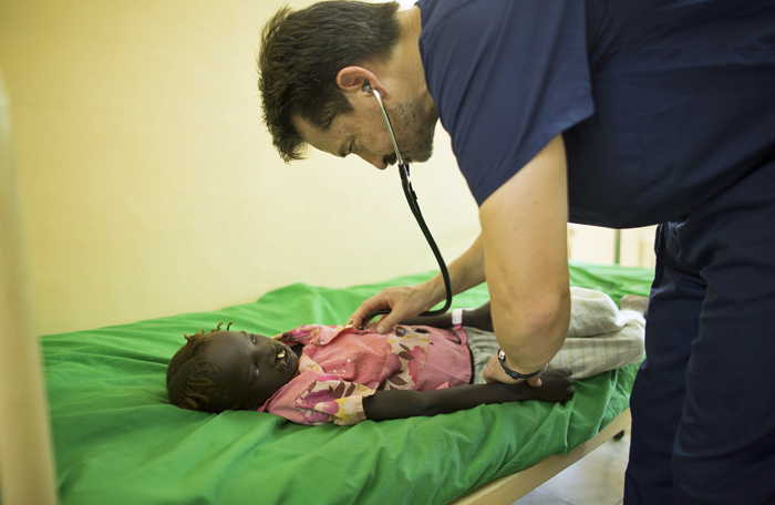 Dr. Lance Plyler examines Tesilia, a 6-year-old girl from Maban County, before her operation. Dr. Plyler was part of the team who helped determine if the patients were healthy enough to undergo surgery.
