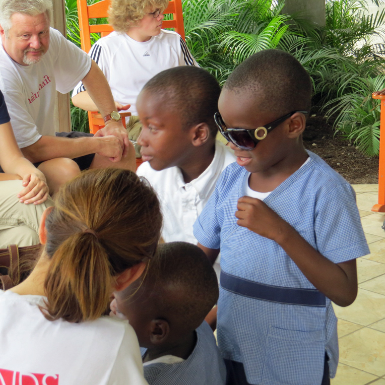 This is Dave, one of the 80 children who attend the Greta Home. While Michele visited, he wore her sunglasses.
