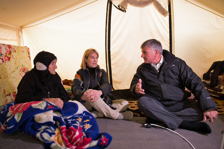 Franklin Graham and Greta Van Susteren visit a 90-year-old refugee in her tent. Graham pledged to provide 2,000 heaters to stave off the cold of winter.
