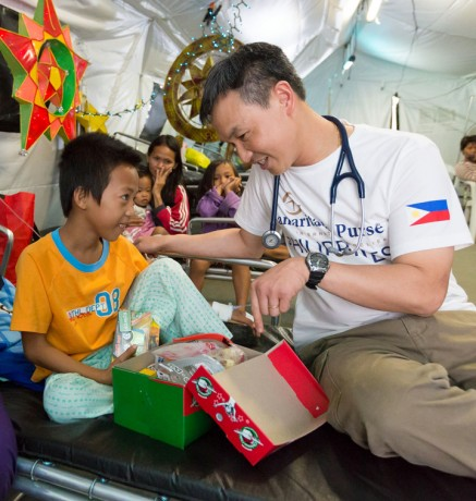 Dr. Azaria Marthyman treated 10-year-old Jomer when he first arrived in Tacloban for medical care. Two days later he gave Jomer an Operation Christmas Child shoebox gift and shared the Gospel with his young patient.
