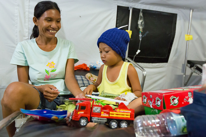 Rhea Martinez brought her son Luke to the Samaritan's Purse field hospital in Tacloban after he fell violently ill. Luke not only received medical care, but he was also given a gift-filled shoebox from Operation Christmas Child.