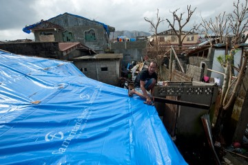 Tarps help keep more rain out of storm-damaged houses.