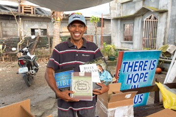 Pastor John Pagliawan was excited to receive the Bibles, hymn books, and books by Billy Graham that Samaritan's Purse President Franklin Graham had promised to him during his November visit.