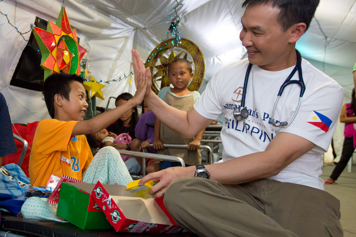 A young boy receives an Operation Christmas Child shoebox at Schistosomiasis Control and Research Hospital.