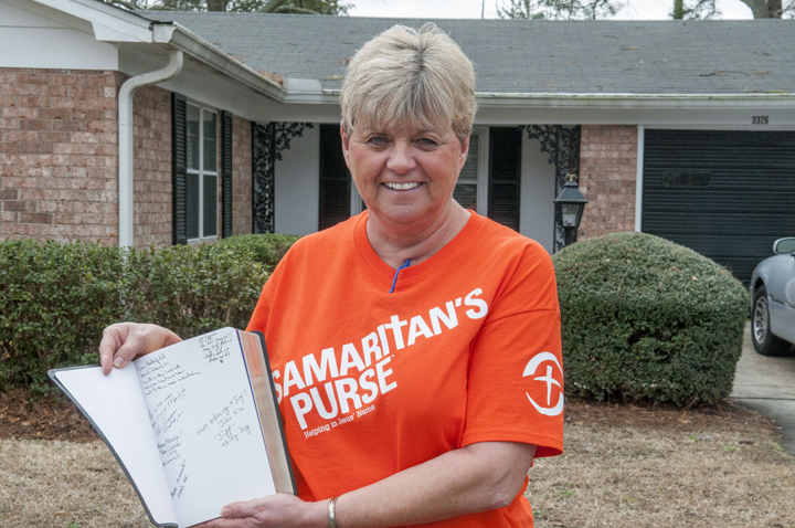 The spiritual support she received from Samaritan's Purse—including a Bible signed by all the volunteers who worked on her property—made  a difference in Saundra's life.