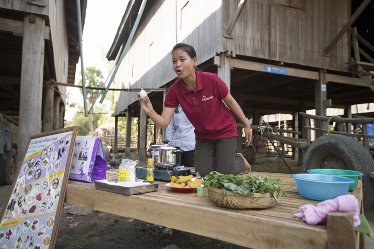A cooking demonstration in Dounmea village, where Samaritan's Purse teaches women about proper hygiene and cooking meals that include eggs, pumpkin, and greens.