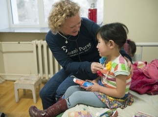 Emily Arneson, program manager for Children's Heart Project in Mongolia, visited Nomin in the hospital before her trip to the United States.