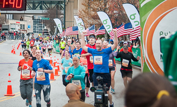 Team SP runners Marisa Baum and Ken Traister (Pastor Reedy's brother-in-law) cross the finish line. They were among the group of runners from his church in Pennsylvania.