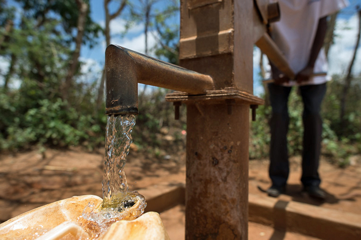 Clean, safe water flows freely from the new hand pump.