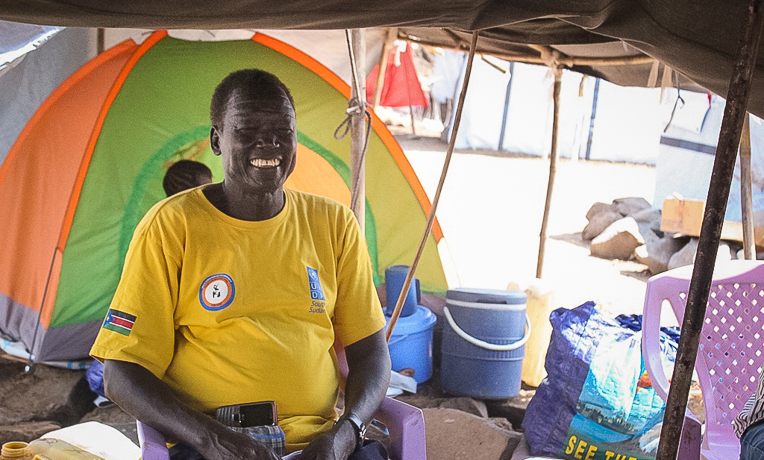 John is one of a group of pastors caring for their neighbors in the camp.