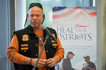 Keith Honeycutt, a chaplain with the Christian Motorcyclists Association, speaks before the ride.