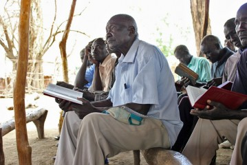 Pastor Solomon helped translate the Bible into Udek.