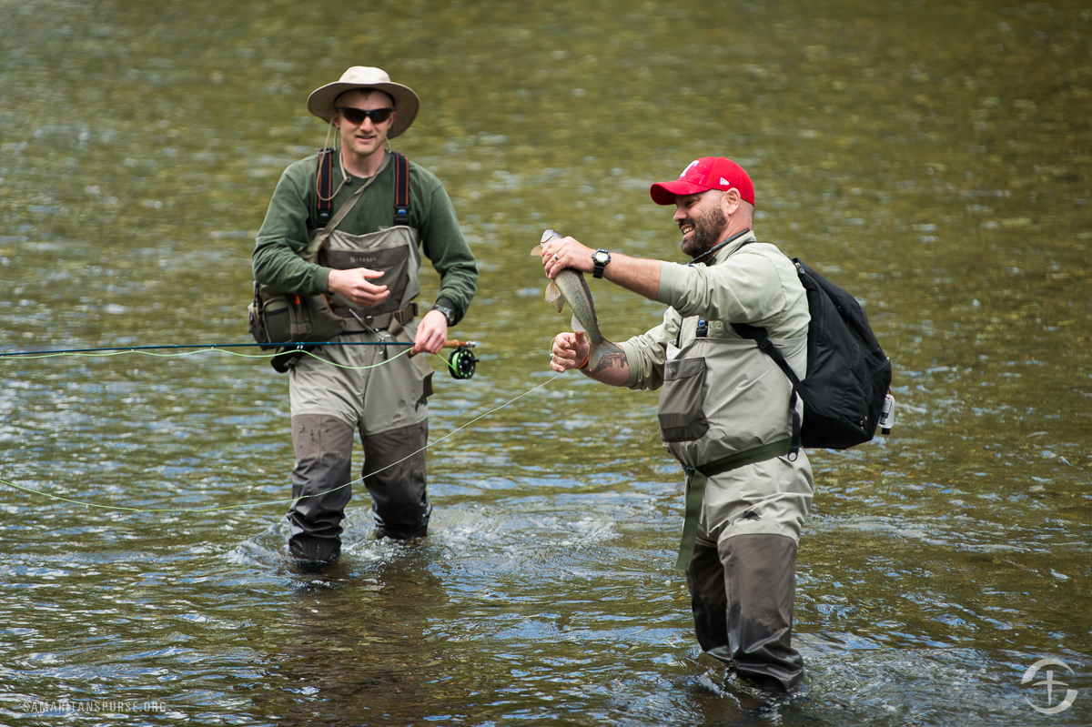 James Taylor hoists his prized catch as guide Carlin Toews looks on.