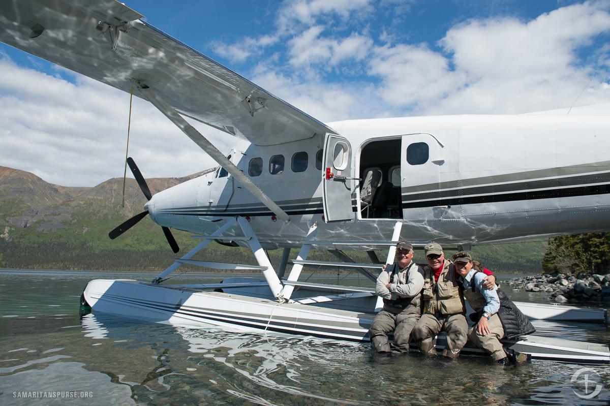 Mark Lang (center), program manager for Samaritan Lodge Alaska, takes a smile break with pilot/guide John Erickson and guide Liz Jones.
