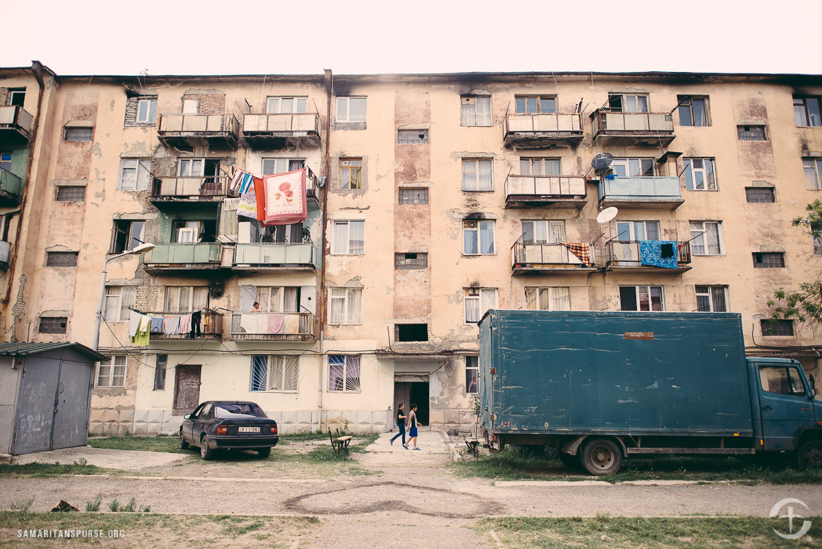 Vaziani is an often-forgotten community in the Republic of Georgia. Soviet soldiers had a base close by and lived in these apartments. The soldiers left after communism fell, and Georgia's poorest people moved into the dilapidated apartments.
