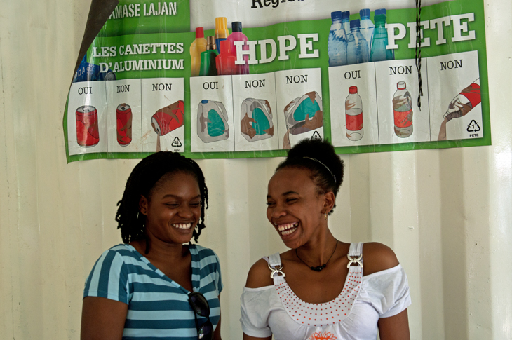 "Health promoters, Chrislande Francois, 26, and Lamita Beauvais, 27, hold trainings at schools. They explain how long it takes for a plastic bottle to biodegrade and encourage students and faculty to utilize Martha's center. They also share the Gospel, drawing a parallel to how God redeems people. ""We let them know how to recycle their lives in Jesus."""