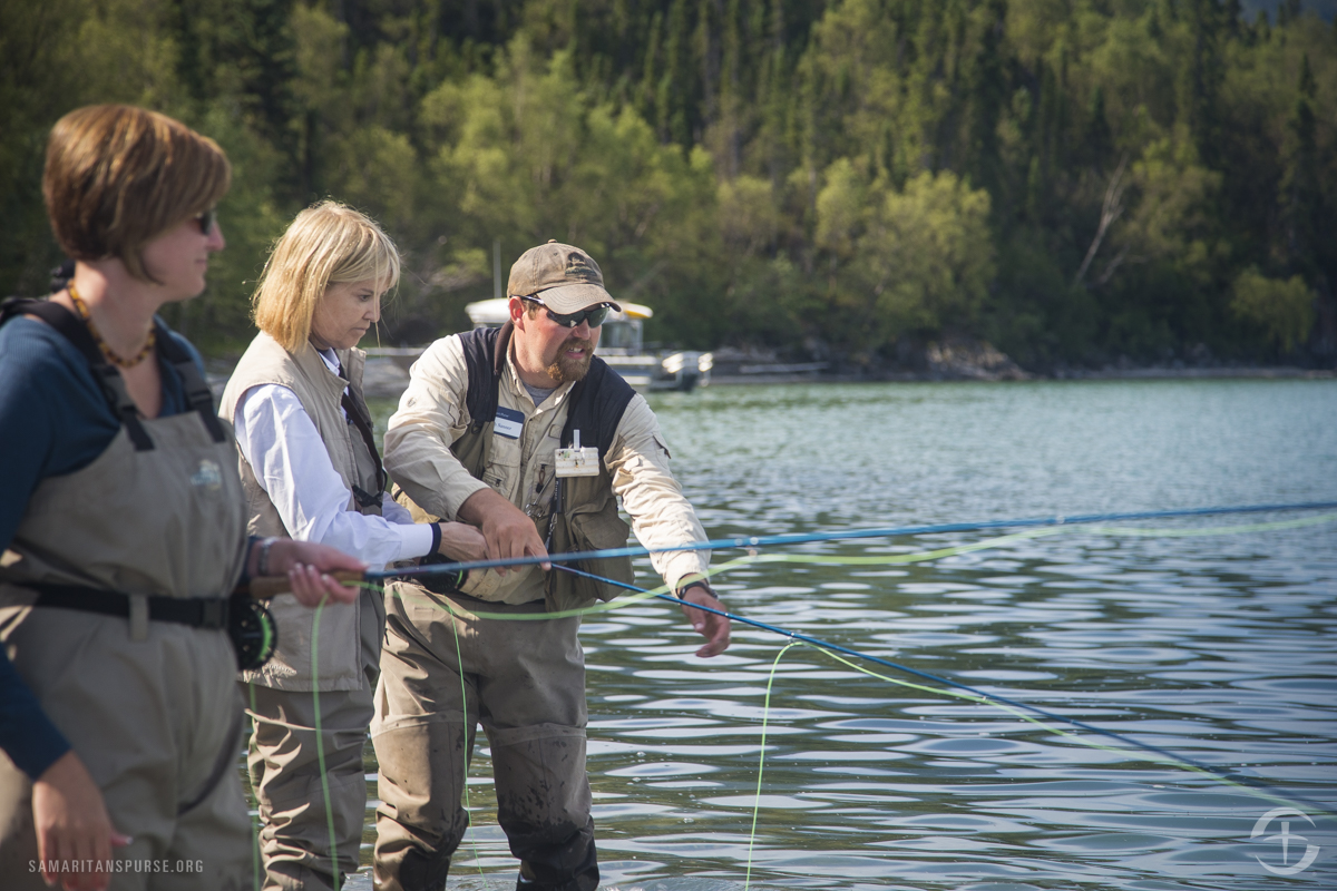 Samaritan Lodge Alaska fishing guide Josh Sanner helps Greta Van Susteren with a fly fishing rod.