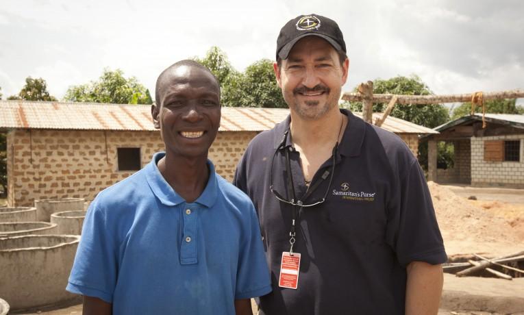 Liberia's first Ebola survivor, Harrison Sakela, poses with Dr. LancePlyler of Samaritan's Purse. Harrison is grateful to be alive.