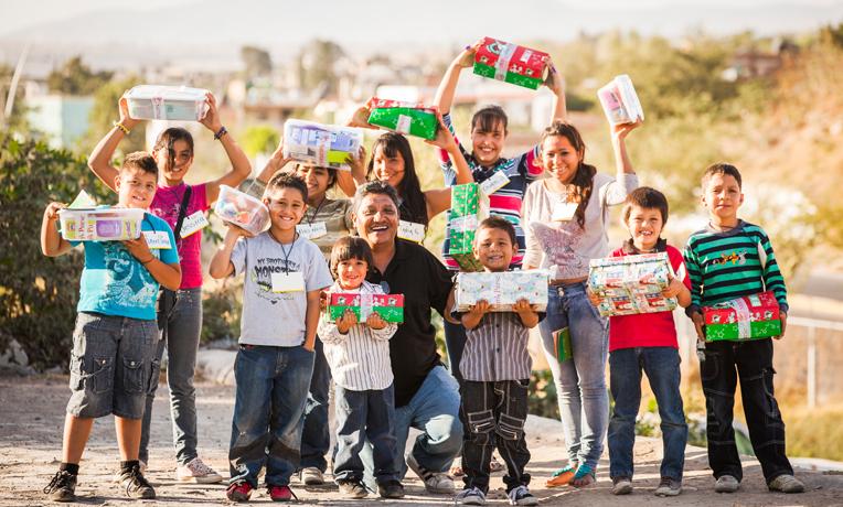 1340MX-J691-Operation-Christmas-Child-hilario_with_kids_8-29