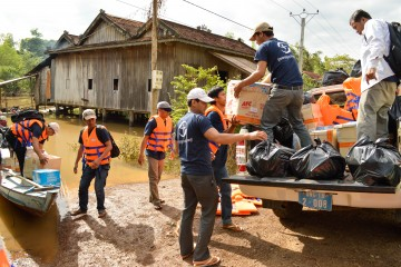 Our teams load a truck with relief items