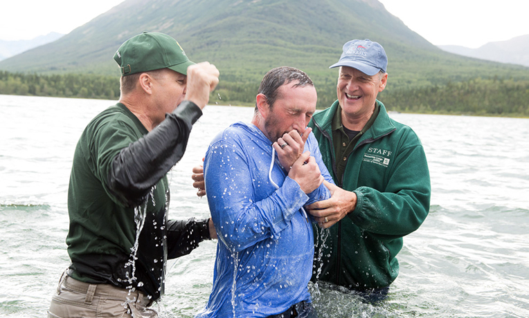 Chaplains Dan Stephens (right) and David Mikkelson baptized Jay Knower.