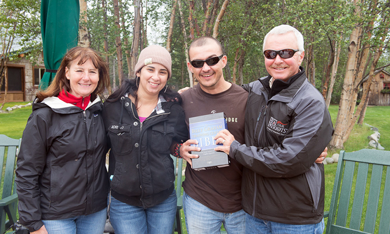 JC and Leslie Arango received a Bible from Mark and Sandy Lang during the fireside farewell. Mark is program manager and Sandy is facilities manager for Samaritan Lodge Alaska.