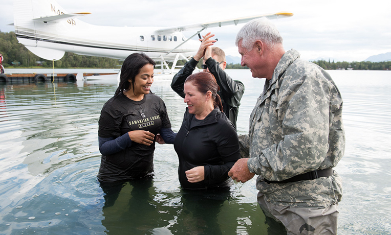 Ingrid Mejia and Allison Masters celebrated their baptisms flanked by General VanAntwerp and Chaplain Dave Mikkelson. Ingrid's husband, Joe Santoscoy, was also baptized after receiving Jesus Christ as Lord and Savior.