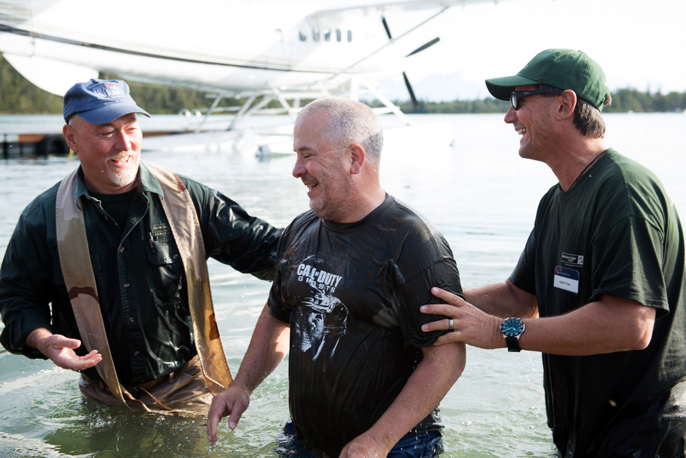 Everyone was all smiles after soldier Todd Halverson was baptized in Lake Clark.