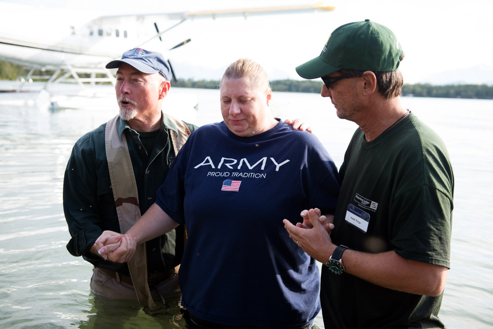 Lisa Halverson prepares to be baptized by retired Navy chaplain Jim Fisher and pastor Keith Pintar. Pastor Pintar of Calvary Chapel in Jacksonville, Florida, is volunteering in Alaska with Samaritan Purse.