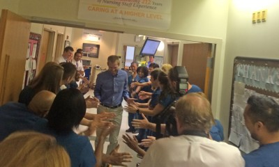 Dr. Kent Brantly ran out of the isolation area giving high fives to his treatment team who had lined the halls.