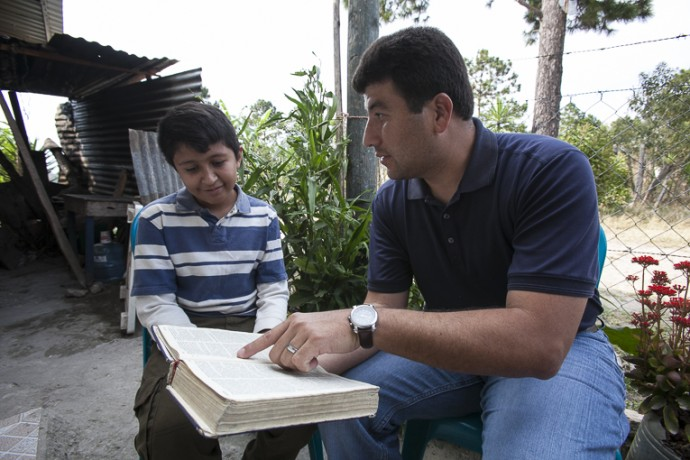 Pastor Murillo delivered a shoebox gift to Denis, and told him about salvation through faith in Jesus.