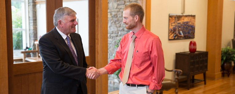 Franklin Graham talks with Kent Brantly when the doctor visited the Samaritan's Purse headquarters after recovering from the Ebola virus.
