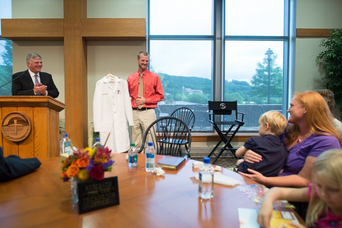 During a visit to Samaritan's Purse headquarters, Franklin Graham presented Dr. Brantly with a new medical coat to replace the one he had to leave behind in Liberia.