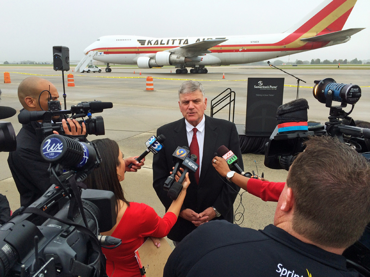 Samaritan's Purse President Franklin Graham speaks to media at the airlift.