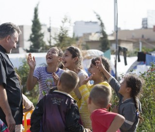 Father Douglas formerly ministered in Baghdad and now cares for a camp of displaced Christians in Erbil.