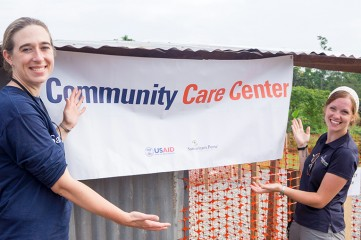 Dr. Nathalie MacDermott (left) and Nurse Judith Hoover (right) were glad to see the center opened after months of hard work.