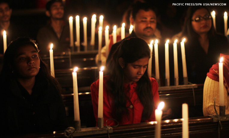 Pakistani Christians gather at Cathedral Church during a pre-Christmas service to pray for the victims of the Peshawar school massacre.