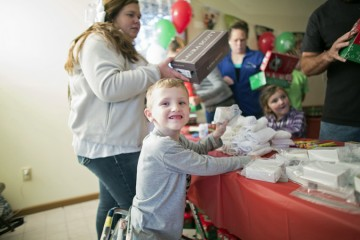 6-year-old Ethan Jackson, another courageous child, helped pack shoebox gifts.