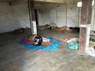 Some families who lost their homes are sleeping outside; others are staying in shelters like this.